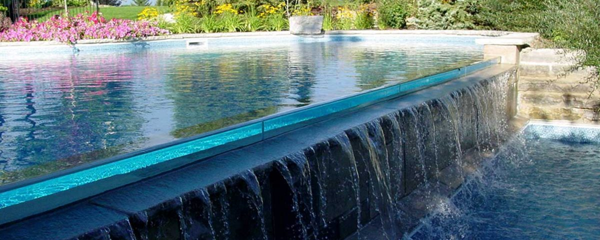In ground swimming pool construction in a sloped - Building a swimming pool on a slope ...